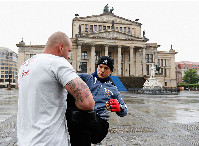 BERLIN, GERMANY - MAY 28:  Nick Hein (R) holds a Guerillia open air training session for fans and media at Gendarmenmarkt on May 28, 2014 in Berlin, Germany.  (Photo by Boris Streubel/Zuffa LLC/Zuffa LLC via Getty Images)