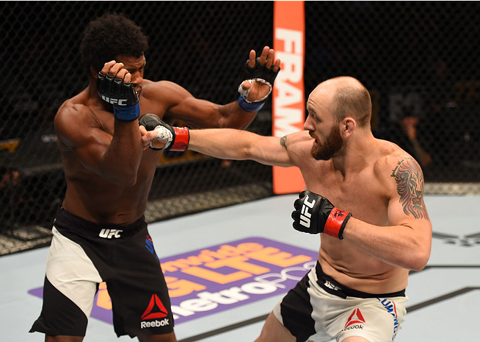 CHICAGO, IL - JULY 25:   (R-L) Zak Cummings punches Dominique Steele in their welterweight bout during the UFC event at the United Center on July 25, 2015 in Chicago, Illinois. (Photo by Jeff Bottari/Zuffa LLC/Zuffa LLC via Getty Images)