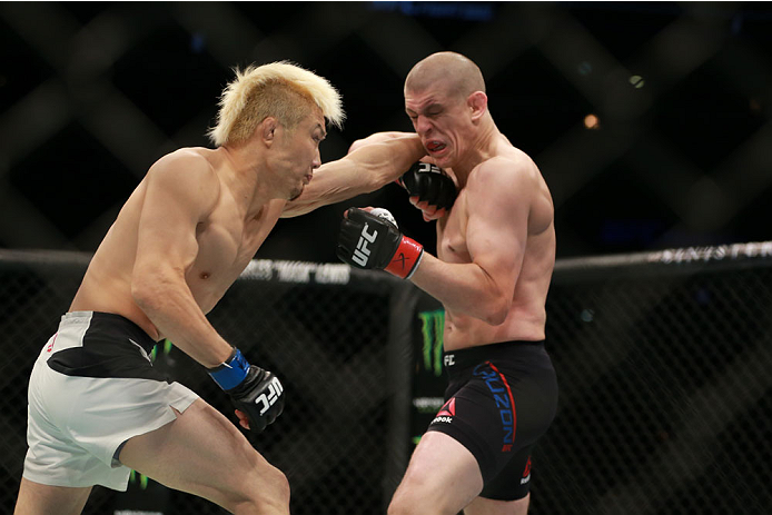 CHICAGO, IL - JULY 25: Takanori Gomi punches Joe Lauzon in their lightweight bout during the UFC event at the United Center on July 25, 2015 in Chicago, Illinois. (Photo by Rey Del Rio/Zuffa LLC/Zuffa LLC via Getty Images)