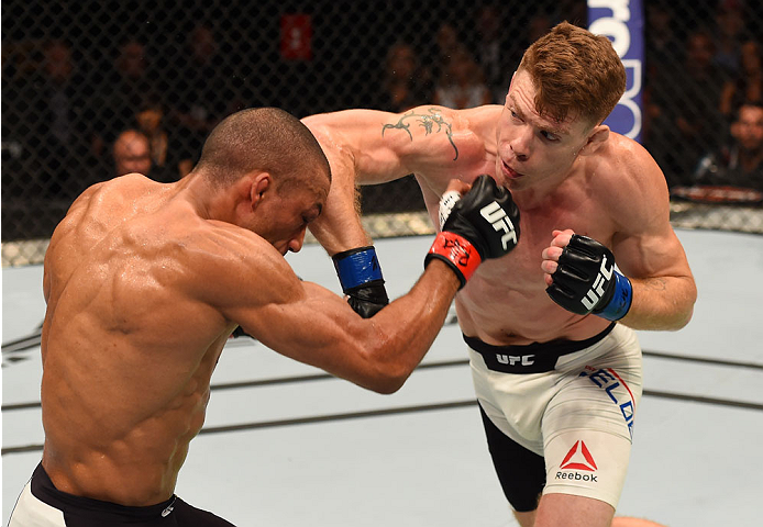 CHICAGO, IL - JULY 25:   (R-L) Paul Felder elbows Edson Barboza of Brazil in their lightweight bout during the UFC event at the United Center on July 25, 2015 in Chicago, Illinois. (Photo by Jeff Bottari/Zuffa LLC/Zuffa LLC via Getty Images)