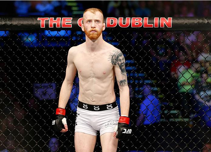 DUBLIN, IRELAND - JULY 19:  Patrick Holohan stands in the Octagon before his flyweight bout against Josh Sampo during the UFC Fight Night event at The O2 Dublin on July 19, 2014 in Dublin, Ireland.  (Photo by Josh Hedges/Zuffa LLC/Zuffa LLC via Getty Images)