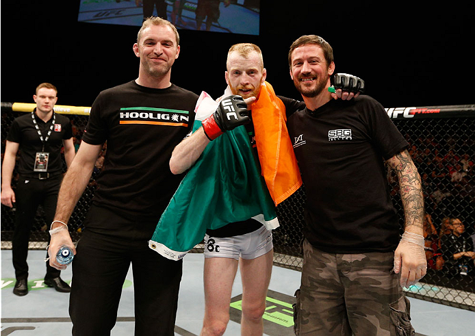 DUBLIN, IRELAND - JULY 19:  Patrick Holohan (C) poses for a photo with his team after his submission victory over Josh Sampo in their flyweight bout during the UFC Fight Night event at The O2 Dublin on July 19, 2014 in Dublin, Ireland.  (Photo by Josh Hedges/Zuffa LLC/Zuffa LLC via Getty Images)