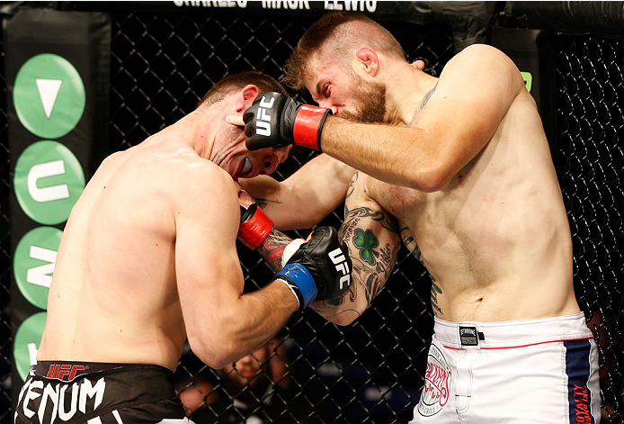 DUBLIN, IRELAND - JULY 19:  (R-L) Cody Donovan connects with a right uppercut against Nikita Krylov in their light heavyweight bout during the UFC Fight Night event at The O2 Dublin on July 19, 2014 in Dublin, Ireland.  (Photo by Josh Hedges/Zuffa LLC/Zuffa LLC via Getty Images)