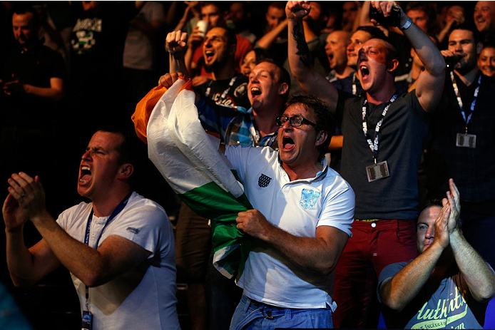 DUBLIN, IRELAND - JULY 19:  A general view of fans cheering on Dublin's Cathal Pendred as he battles Mike King in a middleweight bout during the UFC Fight Night event at The O2 Dublin on July 19, 2014 in Dublin, Ireland.  (Photo by Josh Hedges/Zuffa LLC/Zuffa LLC via Getty Images)