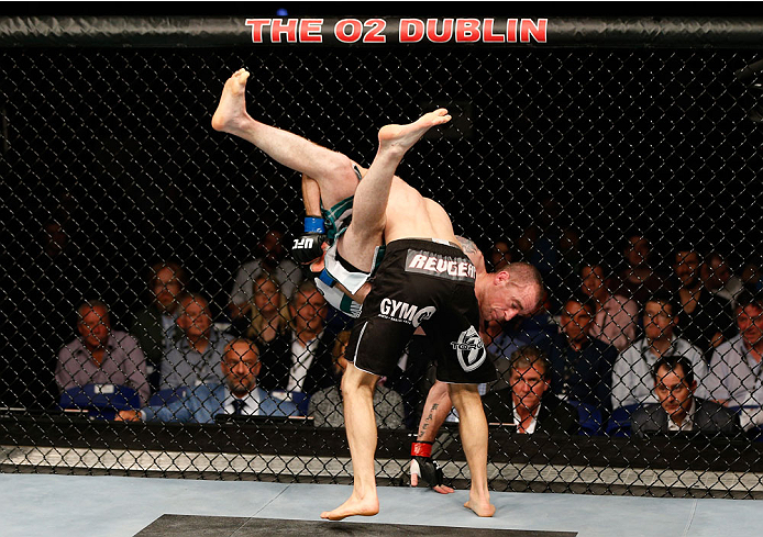 DUBLIN, IRELAND - JULY 19:  Phil Harris (black trunks) takes down Neil Seery in their flyweight bout during the UFC Fight Night event at The O2 Dublin on July 19, 2014 in Dublin, Ireland.  (Photo by Josh Hedges/Zuffa LLC/Zuffa LLC via Getty Images)