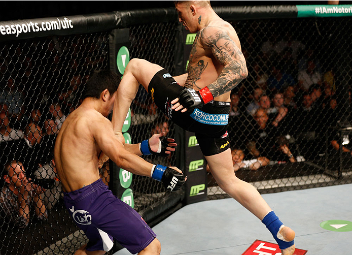 DUBLIN, IRELAND - JULY 19:  (R-L) Norman Parke delivers a flying knee against Naoyuki Kotani in their lightweight bout during the UFC Fight Night event at The O2 Dublin on July 19, 2014 in Dublin, Ireland.  (Photo by Josh Hedges/Zuffa LLC/Zuffa LLC via Getty Images)