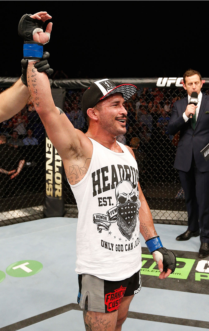 DUBLIN, IRELAND - JULY 19:  Ian McCall celebrates after his unanimous-decision victory over Brad Pickett in their flyweight bout during the UFC Fight Night event at The O2 Dublin on July 19, 2014 in Dublin, Ireland.  (Photo by Josh Hedges/Zuffa LLC/Zuffa LLC via Getty Images)