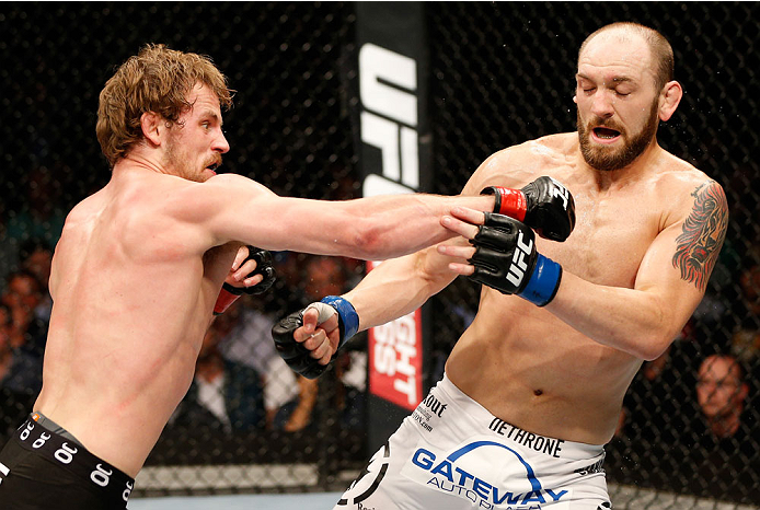 DUBLIN, IRELAND - JULY 19:  (L-R) Gunnar Nelson connects with a right to the head of Zak Cummings in their welterweight bout during the UFC Fight Night event at The O2 Dublin on July 19, 2014 in Dublin, Ireland.  (Photo by Josh Hedges/Zuffa LLC/Zuffa LLC via Getty Images)