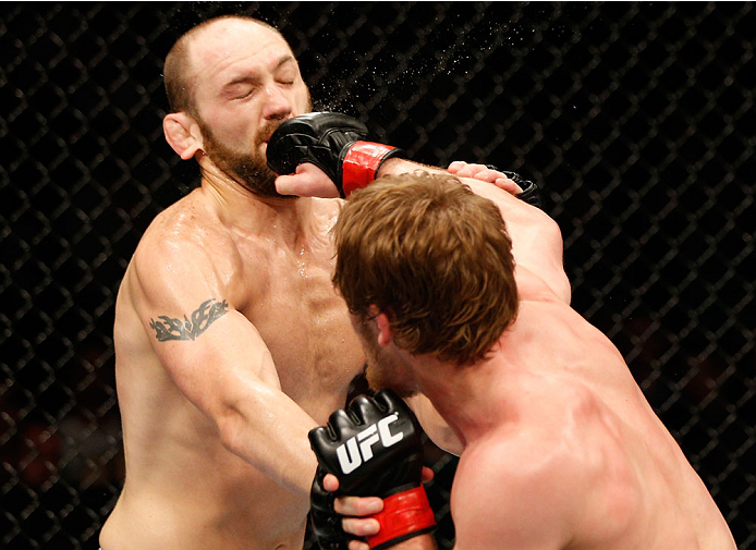 DUBLIN, IRELAND - JULY 19:  (R-L) Gunnar Nelson connects with a right to the head of Zak Cummings in their welterweight bout during the UFC Fight Night event at The O2 Dublin on July 19, 2014 in Dublin, Ireland.  (Photo by Josh Hedges/Zuffa LLC/Zuffa LLC via Getty Images)