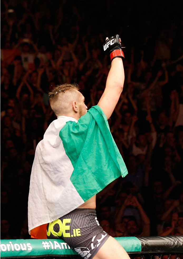 DUBLIN, IRELAND - JULY 19:  Conor McGregor celebrates after his TKO victory over Diego Brandao in their featherweight bout during the UFC Fight Night event at The O2 Dublin on July 19, 2014 in Dublin, Ireland.  (Photo by Josh Hedges/Zuffa LLC/Zuffa LLC via Getty Images)