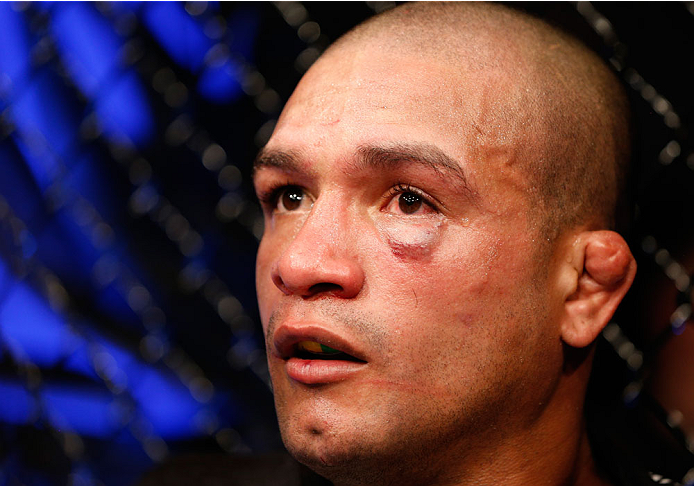 DUBLIN, IRELAND - JULY 19:  Diego Brandao reacts after his TKO loss to Conor McGregor in their featherweight bout during the UFC Fight Night event at The O2 Dublin on July 19, 2014 in Dublin, Ireland.  (Photo by Josh Hedges/Zuffa LLC/Zuffa LLC via Getty Images)