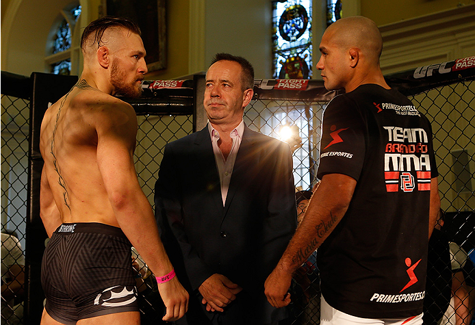 DUBLIN, IRELAND - JULY 16:  (L-R) Opponents Conor McGregor and Diego Brandao face off during the UFC media day at Royal Hospital Kilmainham on July 16, 2014 in Dublin, Ireland. (Photo by Josh Hedges/Zuffa LLC/Zuffa LLC via Getty Images)