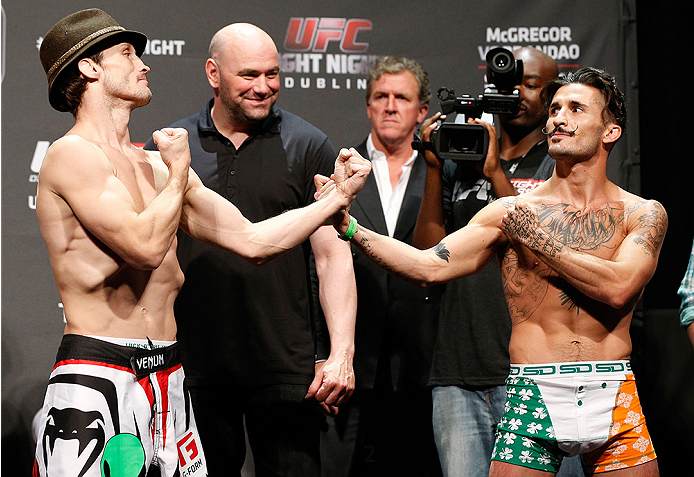 DUBLIN, IRELAND - JULY 18:  (L-R) Opponents Brad Pickett and Ian McCall face off during the UFC weigh-in event at The O2 on July 18, 2014 in Dublin, Ireland.  (Photo by Josh Hedges/Zuffa LLC/Zuffa LLC via Getty Images)