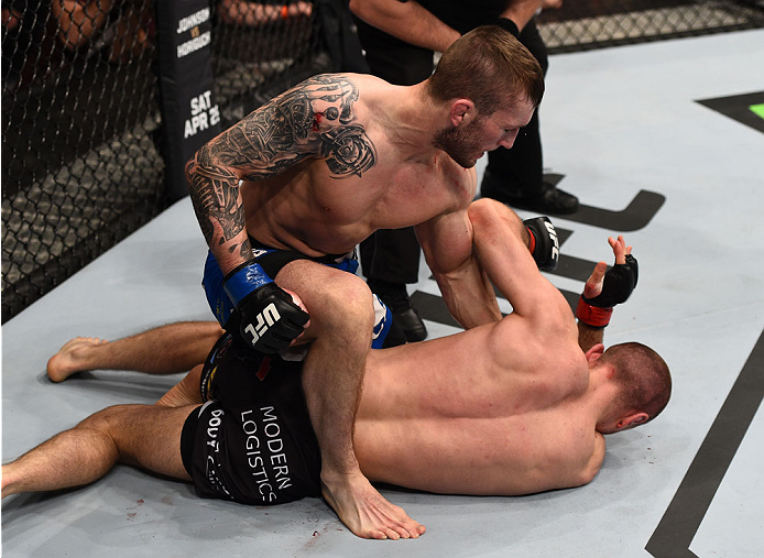 (L-R) Stevie Ray of Scotland defeats Marcin Bandel of Poland by TKO in their lightweight fight during the UFC Fight Night event at the Tauron Arena on April 11, 2015 in Krakow, Poland. (Photo by Jeff Bottari/Zuffa LLC)
