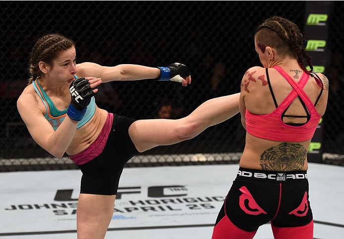 Maryna Moroz kicks Joanne Calderwood in their women's strawweight fight during the UFC Fight Night event at the Tauron Arena on April 11, 2015 in Krakow, Poland. (Photo by Jeff Bottari/Zuffa LLC)