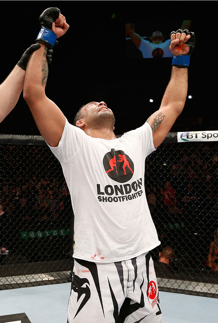 LONDON, ENGLAND - MARCH 08:  Claudio Silva reacts after his victory over Brad Scott in their middleweight fight during the UFC Fight Night London event at the O2 Arena on March 8, 2014 in London, England. (Photo by Josh Hedges/Zuffa LLC/Zuffa LLC via Getty Images)