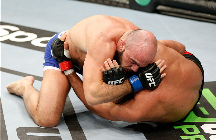 LONDON, ENGLAND - MARCH 08:  (L-R) Ilir Latifi secures a choke submission against Cyrille Diabate in their light heavyweight fight during the UFC Fight Night London event at the O2 Arena on March 8, 2014 in London, England. (Photo by Josh Hedges/Zuffa LLC/Zuffa LLC via Getty Images)
