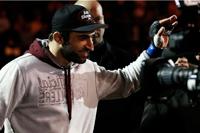 LONDON, ENGLAND - MARCH 08:  Omari Akhmedov enters the arena before his welterweight fight against Gunnar Nelson during the UFC Fight Night London event at the O2 Arena on March 8, 2014 in London, England. (Photo by Josh Hedges/Zuffa LLC/Zuffa LLC via Getty Images)