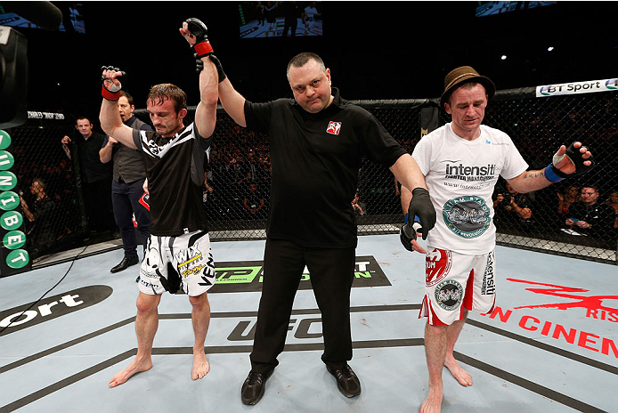 LONDON, ENGLAND - MARCH 08:  Brad Pickett (L) reacts after his victory over Neil Seery in their flyweight fight during the UFC Fight Night London event at the O2 Arena on March 8, 2014 in London, England. (Photo by Josh Hedges/Zuffa LLC/Zuffa LLC via Getty Images)