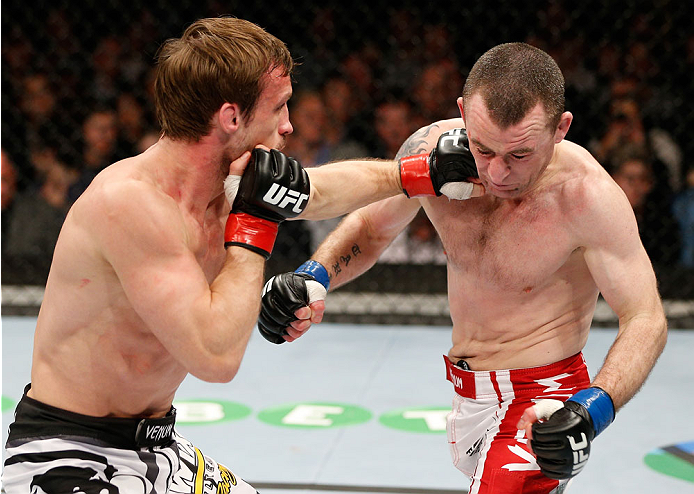 LONDON, ENGLAND - MARCH 08:  (L-R) Brad Pickett punches Neil Seery in their flyweight fight during the UFC Fight Night London event at the O2 Arena on March 8, 2014 in London, England. (Photo by Josh Hedges/Zuffa LLC/Zuffa LLC via Getty Images)