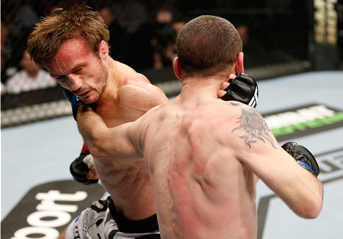 LONDON, ENGLAND - MARCH 08:  (R-L) Neil Seery punches Brad Pickett in their flyweight fight during the UFC Fight Night London event at the O2 Arena on March 8, 2014 in London, England. (Photo by Josh Hedges/Zuffa LLC/Zuffa LLC via Getty Images)