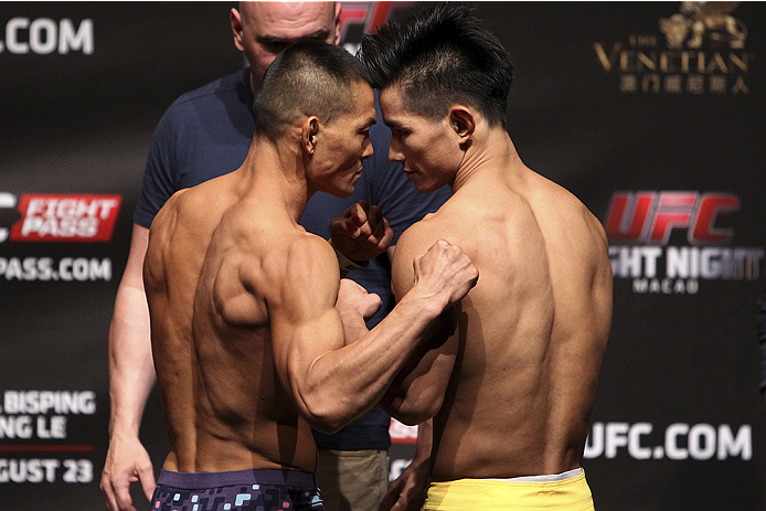 MACAU - AUGUST 22:  (L and R) Ning Guangyou and Yang Jianping during the UFC weigh-in event at the Venetian Macau on August 22, 2014 in Macau, Macau.. (Photo by Mitch Viquez/Zuffa LLC/Zuffa LLC via Getty Images)