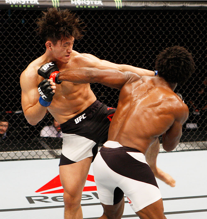 SEOUL, SOUTH KOREA - NOVEMBER 28: (From L to R) Dong Hyun Kim of South Korea  and Dominique Steele of the United States of America exchange strikes  in their lightweight bout during the UFC Fight Night at the Olympic Park Gymnastics Arena on November 28, 2015 in Seoul, South Korea. (Photo by Mitch Viquez/Zuffa LLC/Zuffa LLC via Getty Images)