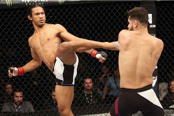 SEOUL, SOUTH KOREA - NOVEMBER 28: Benson Henderson of the United States of America throws a kick at Jorge Masvidal of the United States of America in their welterweight bout during the UFC Fight Night at the Olympic Park Gymnastics Arena on November 28, 2015 in Seoul, South Korea. (Photo by Mitch Viquez/Zuffa LLC/Zuffa LLC via Getty Images)