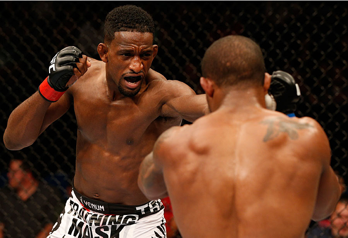 TULSA, OK - AUGUST 23:  (L-R) Neil Magny punches Alex Garcia of the Dominican Republic in their welterweight fight during the UFC Fight Night event at the BOK Center on August 23, 2014 in Tulsa, Oklahoma. (Photo by Josh Hedges/Zuffa LLC/Zuffa LLC via Getty Images)