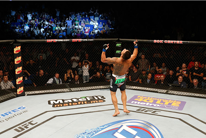 TULSA, OK - AUGUST 23:  Rafael dos Anjos of Brazil celebrates after his knockout victory over Benson Henderson in their lightweight fight during the UFC Fight Night event at the BOK Center on August 23, 2014 in Tulsa, Oklahoma. (Photo by Josh Hedges/Zuffa LLC/Zuffa LLC via Getty Images)