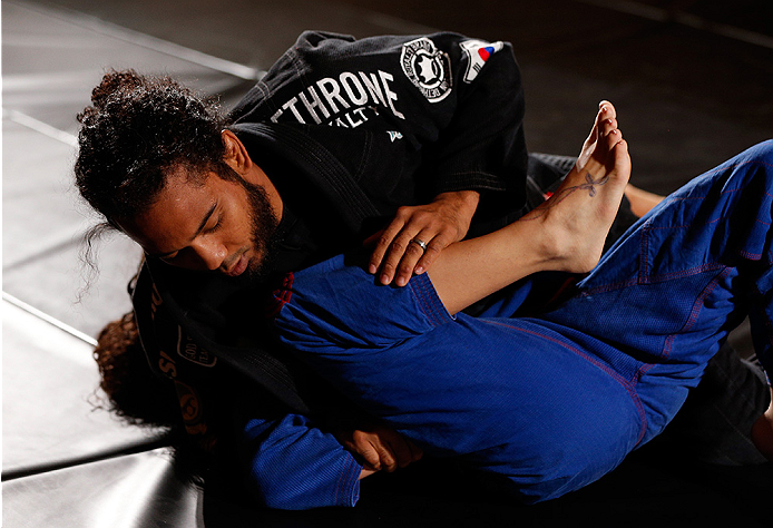 TULSA, OK - AUGUST 21: (R-L) Benson Henderson grapples with his wife Maria during a UFC open training session for media and fans at the Hyatt Regency Hotel on August 21, 2014 in Tulsa, Oklahoma. (Photo by Josh Hedges/Zuffa LLC/Zuffa LLC via Getty Images)
