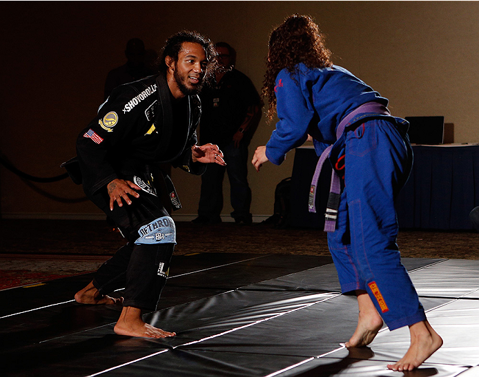 Benson Henderson grapples with his wife Maria at open workouts