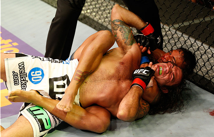 SAN JOSE, CA - JULY 26:  (R-L) Dennis Bermudez secures a rear choke submission against Clay Guida in their featherweight bout during the UFC Fight Night event at SAP Center on July 26, 2014 in San Jose, California.  (Photo by Josh Hedges/Zuffa LLC/Zuffa LLC via Getty Images)