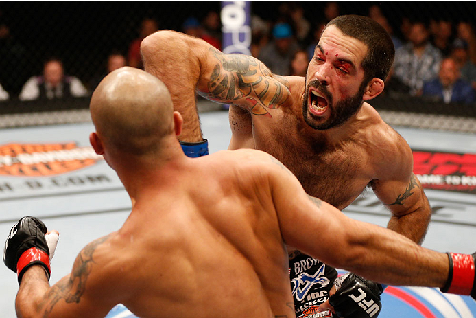SAN JOSE, CA - JULY 26:  (R-L) Matt Brown punches Robbie Lawler in their welterweight bout during the UFC Fight Night event at SAP Center on July 26, 2014 in San Jose, California.  (Photo by Josh Hedges/Zuffa LLC/Zuffa LLC via Getty Images)