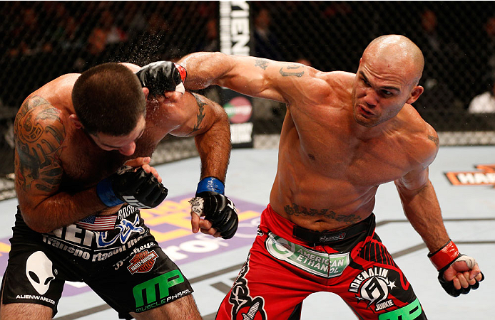 (L-R) Robbie Lawler punches Matt Brown in their welterweight bout during the UFC Fight Night event at SAP Center on July 26, 2014 in San Jose, CA. (Photo by Josh Hedges/Zuffa LLC)