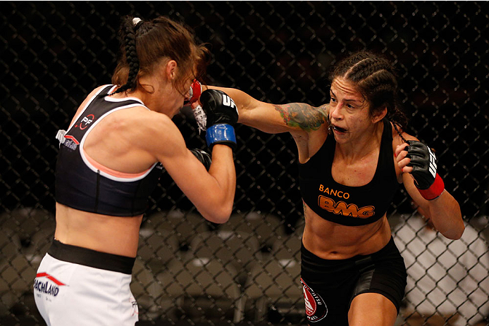SAN JOSE, CA - JULY 26:  (R-L) Julianna Lima punches Joanna Jedrzejczyk in their womens strawweight bout during the UFC Fight Night event at SAP Center on July 26, 2014 in San Jose, California.  (Photo by Josh Hedges/Zuffa LLC/Zuffa LLC via Getty Images)
