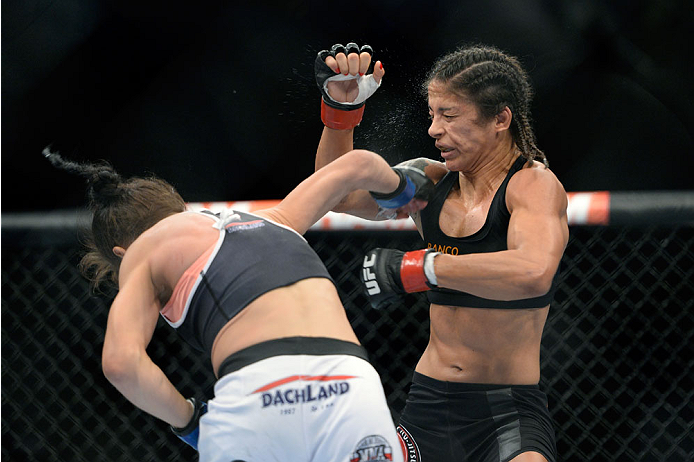 SAN JOSE, CA - JULY 26: (L-R) Joanna Jedrzejczyk punches Julianna Lima in their women's strawweight bout during the UFC Fight Night event at the SAP Center on July 26, 2014 in San Jose, California. (Photo by Jeff Bottari/Zuffa LLC/Zuffa LLC via Getty Images)