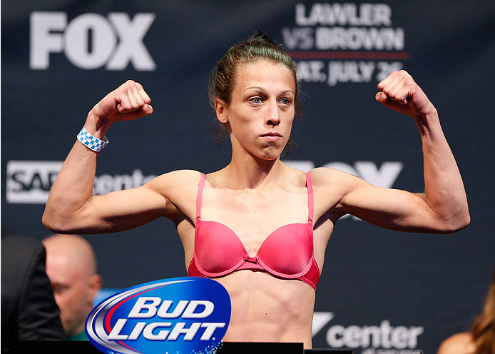 SAN JOSE, CA - JULY 25:  Joanna Jedrzejczyk poses on the scale after making weight during the UFC fight night weigh-in at the SAP Center on July 25, 2014 in San Jose, California.  (Photo by Josh Hedges/Zuffa LLC/Zuffa LLC via Getty Images)