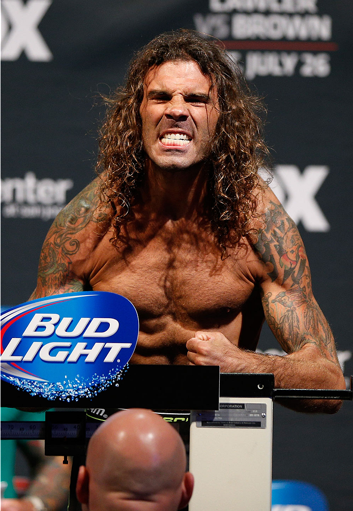 SAN JOSE, CA - JULY 25:  Clay Guida poses on the scale after making weight during the UFC fight night weigh-in at the SAP Center on July 25, 2014 in San Jose, California.  (Photo by Josh Hedges/Zuffa LLC/Zuffa LLC via Getty Images)