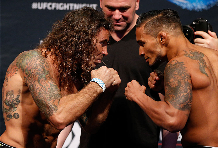 SAN JOSE, CA - JULY 25:  (L-R) Opponents Clay Guida and Dennis Bermudez face off during the UFC fight night weigh-in at the SAP Center on July 25, 2014 in San Jose, California.  (Photo by Josh Hedges/Zuffa LLC/Zuffa LLC via Getty Images)