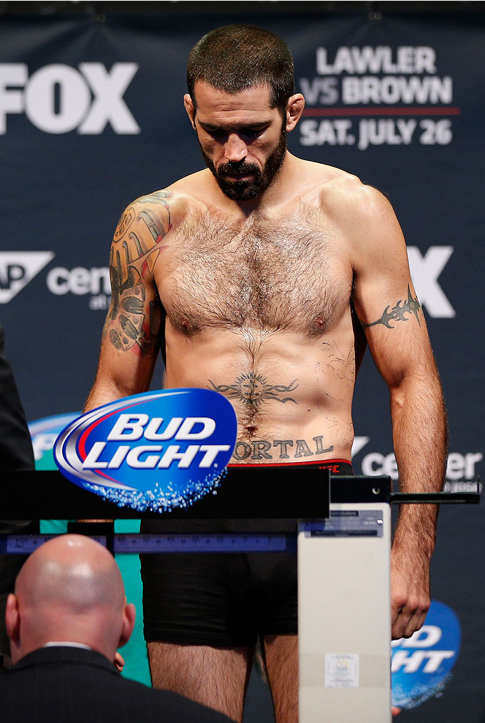 SAN JOSE, CA - JULY 25:  Matt Brown stands on the scale as he attempts to make weight during the UFC fight night weigh-in at the SAP Center on July 25, 2014 in San Jose, California.  (Photo by Josh Hedges/Zuffa LLC/Zuffa LLC via Getty Images)