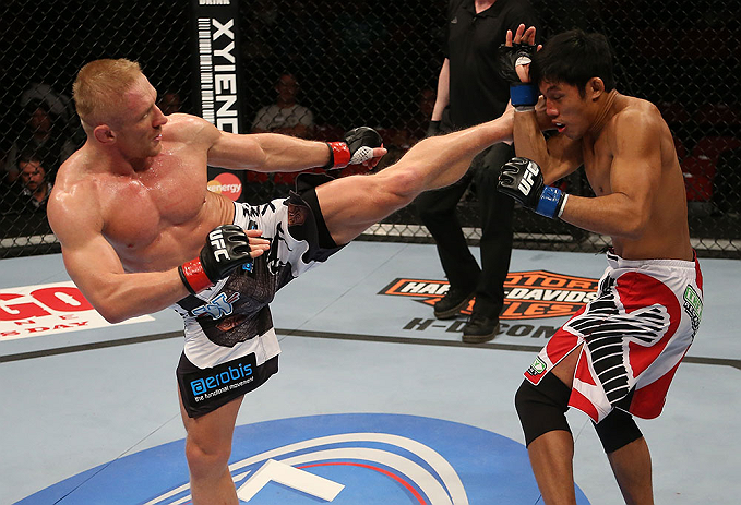 SEATTLE, WA - DECEMBER 08:  (L-) Dennis Siver kicks Nam Phan during their featherweight bout at the UFC on FOX event on December 8, 2012  at Key Arena in Seattle, Washington.  (Photo by Ezra Shaw/Zuffa LLC/Zuffa LLC via Getty Images) *** Local Caption *** Dennis Siver; Nam Phan