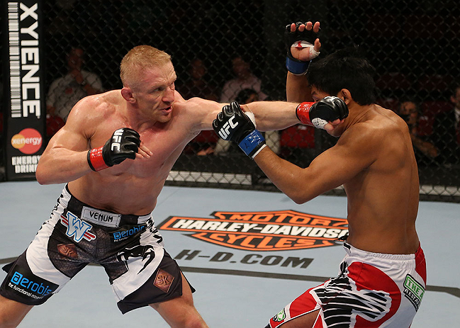 (L-R) Dennis Siver punches <a href='../fighter/Nam-Phan'>Nam Phan</a> during their featherweight bout at the UFC on FOX event on December 8, 2012 at Key Arena in Seattle, Washington. (Photo by Ezra Shaw/Zuffa LLC)