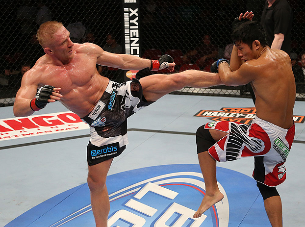SEATTLE, WA - DECEMBER 08:  (L-R) Dennis Siver kicks Nam Phan during their featherweight bout at the UFC on FOX event on December 8, 2012  at Key Arena in Seattle, Washington.  (Photo by Ezra Shaw/Zuffa LLC/Zuffa LLC via Getty Images) *** Local Caption *** Dennis Siver; Nam Phan