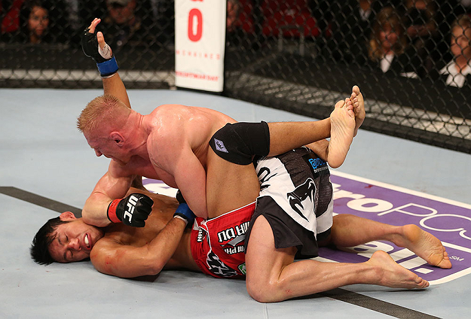 SEATTLE, WA - DECEMBER 08:  Dennis Siver (top) elbows Nam Phan (bottom)during their featherweight bout at the UFC on FOX event on December 8, 2012  at Key Arena in Seattle, Washington.  (Photo by Ezra Shaw/Zuffa LLC/Zuffa LLC via Getty Images) *** Local Caption *** Dennis Siver; Nam Phan