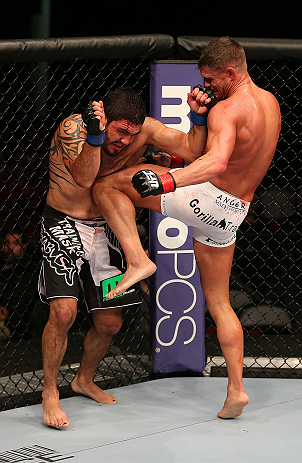 SEATTLE, WA - DECEMBER 08:  (R-L) Daron Cruickshank knees Henry Martinez  during their lightweight bout at the UFC on FOX event on December 8, 2012  at Key Arena in Seattle, Washington.  (Photo by Ezra Shaw/Zuffa LLC/Zuffa LLC via Getty Images) *** Local Caption *** Daron Cruickshank; Henry Martinez