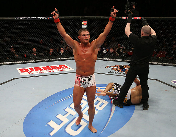 SEATTLE, WA - DECEMBER 08:  Daron Cruickshank reacts to his knockout victory over Henry Martinez during their lightweight bout at the UFC on FOX event on December 8, 2012  at Key Arena in Seattle, Washington.  (Photo by Ezra Shaw/Zuffa LLC/Zuffa LLC via Getty Images) *** Local Caption *** Daron Cruickshank; Henry Martinez