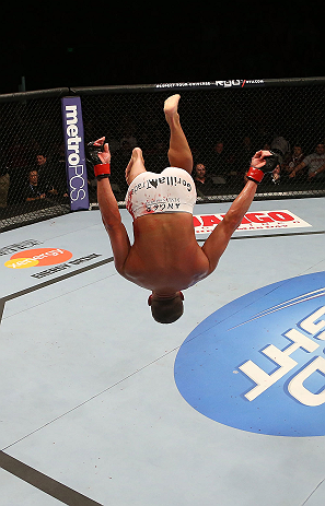 SEATTLE, WA - DECEMBER 08:  Daron Cruickshank does a backflip after his knockout victory over Henry Martinez during their lightweight bout at the UFC on FOX event on December 8, 2012  at Key Arena in Seattle, Washington.  (Photo by Ezra Shaw/Zuffa LLC/Zuffa LLC via Getty Images) *** Local Caption *** Daron Cruickshank; Henry Martinez