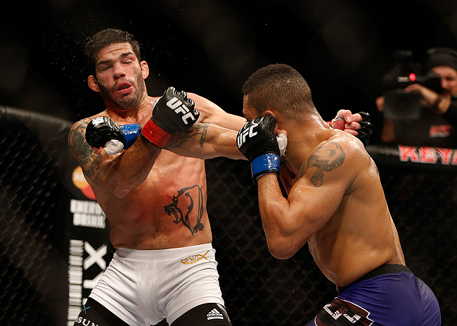 SEATTLE, WA - DECEMBER 08:  (R-L) Mike Easton punches Raphael Assuncao during their bantamweight bout at the UFC on FOX event on December 8, 2012  at Key Arena in Seattle, Washington.  (Photo by Ezra Shaw/Zuffa LLC/Zuffa LLC via Getty Images) *** Local Caption *** Raphael Assuncao; Mike Easton