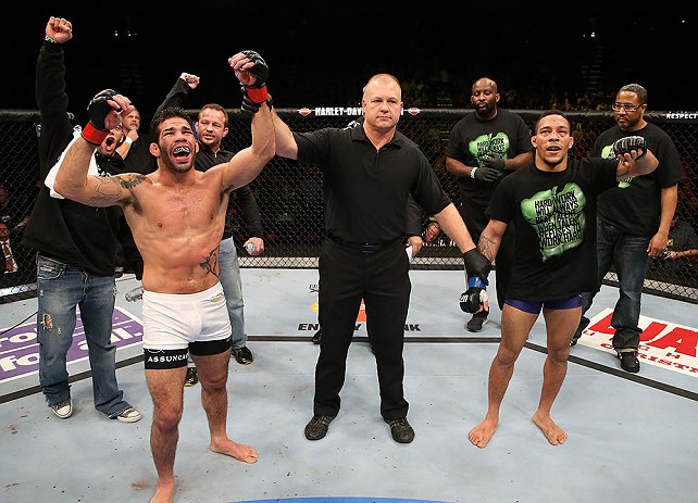 SEATTLE, WA - DECEMBER 08:  Raphael Assuncao (left) reacts to being declared the winner over Mike Easton (right) after their bantamweight bout at the UFC on FOX event on December 8, 2012  at Key Arena in Seattle, Washington.  (Photo by Ezra Shaw/Zuffa LLC/Zuffa LLC via Getty Images) *** Local Caption *** Raphael Assuncao; Mike Easton